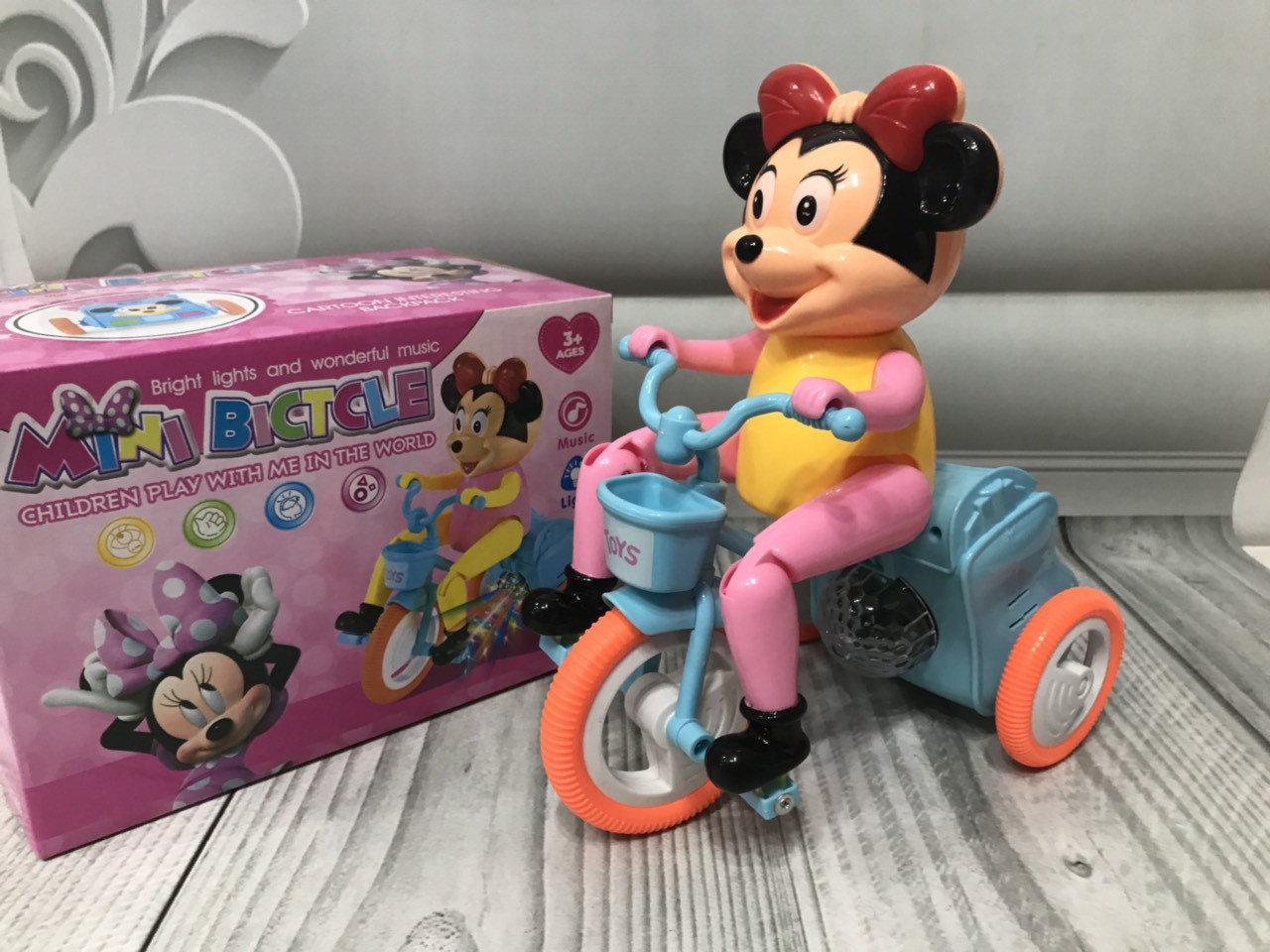Музыкальная игрушка Минни маус на велосипеде