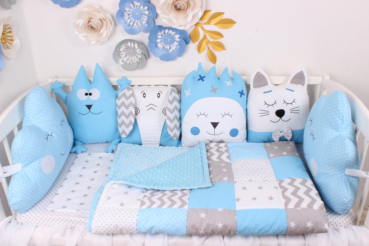 Комплект в кроватку с игрушками в голубых тонах