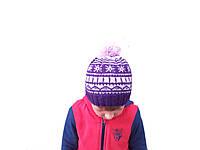 Вязанная зимняя детская шапка ручной работы