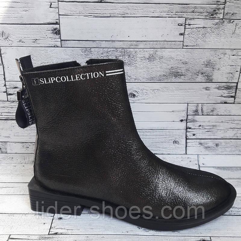 Кожаные женские ботинки на низком каблуке