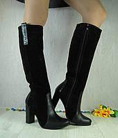 Женские сапоги из натуральной замши и кожи, чёрного цвета, на средней высоты каблуке.