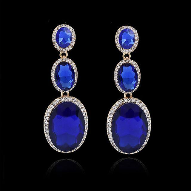 Висячі сережки - Сяючі овали (Золоті з синім каменем)