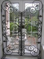 Кованая дверь решётка