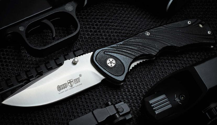 Нож складной с мощным и прочным клинком, с массивной фурнитурой, накладки рукояти из материала G-10