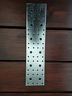 Пластина  крепежная перфорированая 70х300х2.