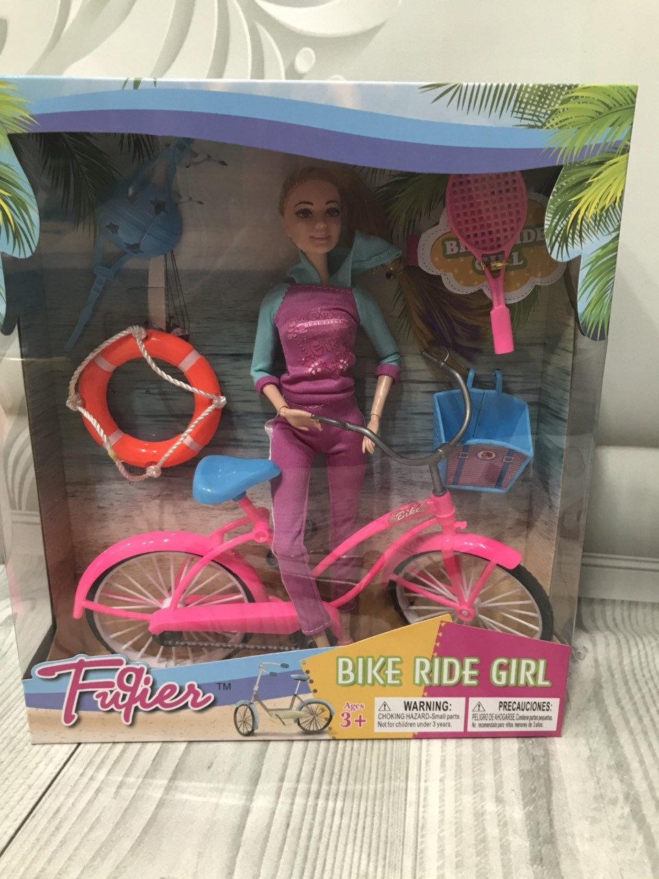 Кукла с велосипедом