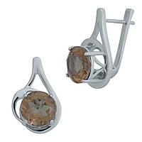 Родированые серебряные серьги 925 пробы с султанитом