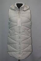 Стильная женская удлиненная  стеганная жилетка фабричный Китай белая
