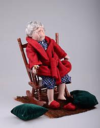 Порцелянова лялька Дідусь у кріслі ,46 см