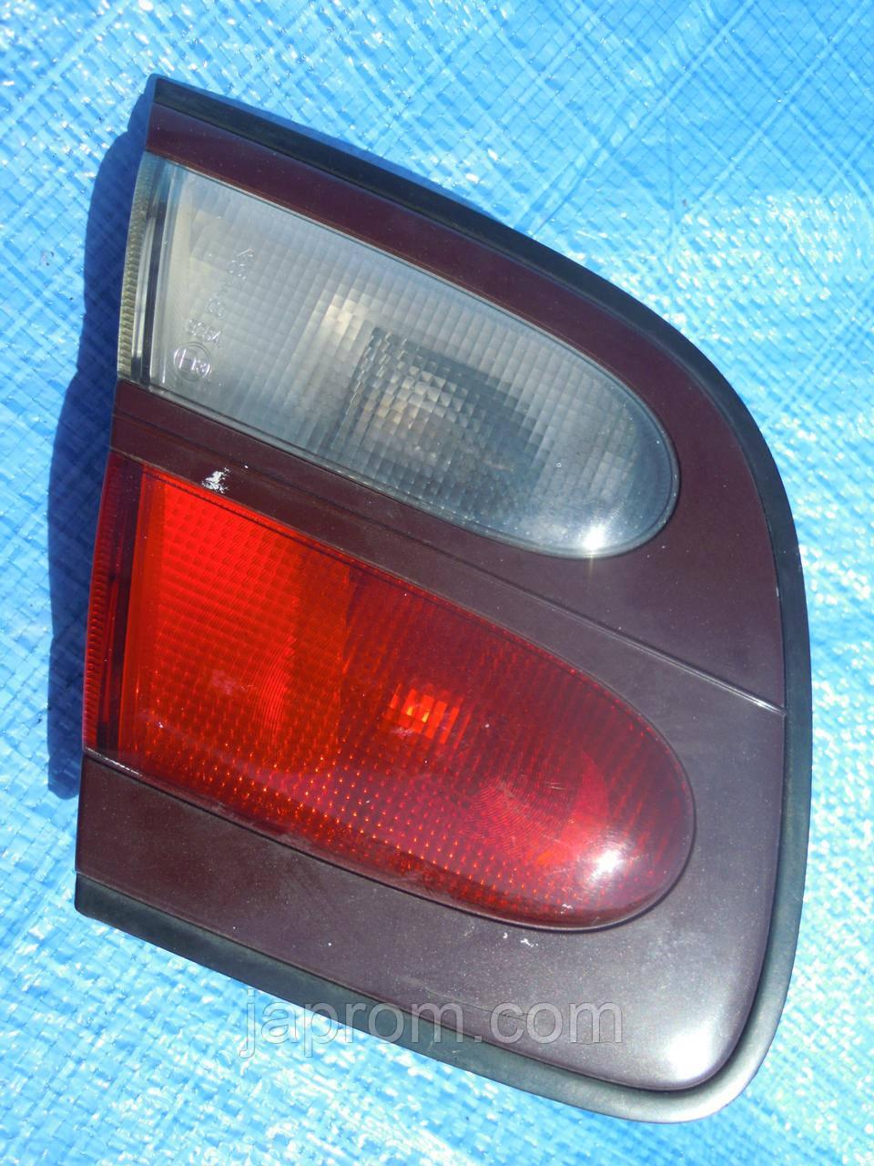 Фонарь крышки багажника левый Nissan Almera N15 1999-2000г.в.3дв. 5дв рестайл