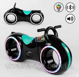 Детский мотоцикл (трон-байк). Подсветка. Прослушивание музыки через bluetooth. Т 0202