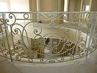 Кованные  балконы и лестницы