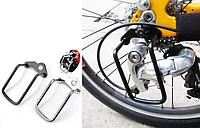 Захист велосипедного заднього перемикача швидкостей (перекидки)