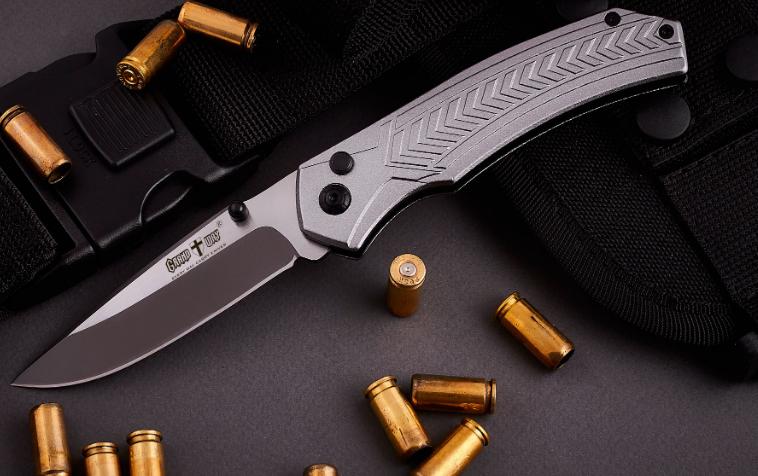 Нож складной, цельнометаллическая конструкция, фальшлезвие на всю длину обуха, анодированные спуски клинка