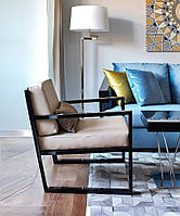 Кресло с мягкими подушками в стиле лофт.