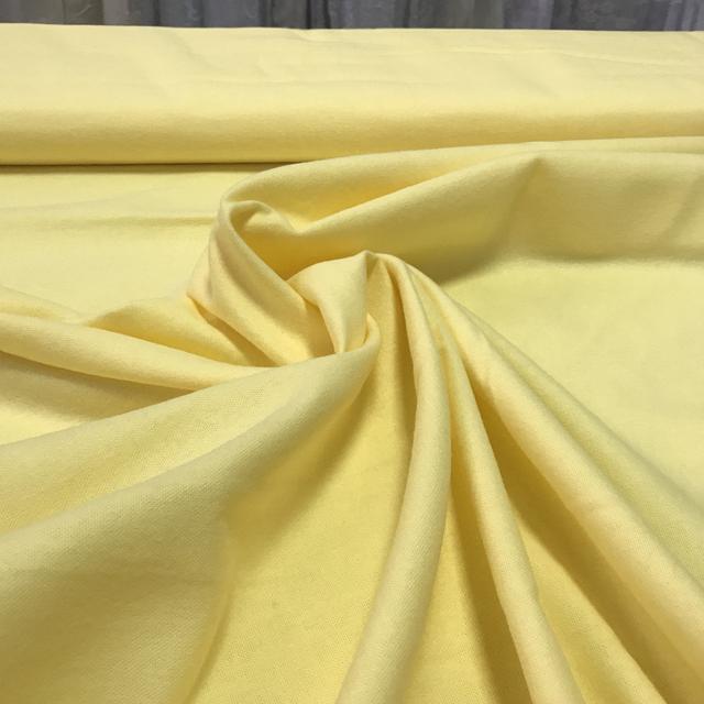 Однотонная желтая фланель с шириной 95 см