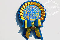Желто голубой с бантиком значок для детского сада