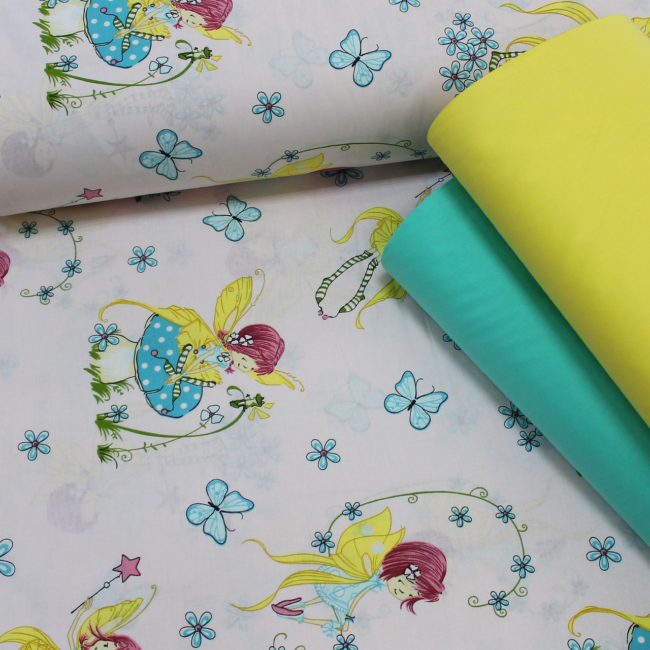 Хлопковая ткань (ТУРЦИЯ шир. 2,4 м) фея с желтыми крыльями и голубыми цветами