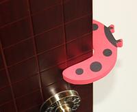 Захист-стопер на двері, висувні ящики та інші конструкції
