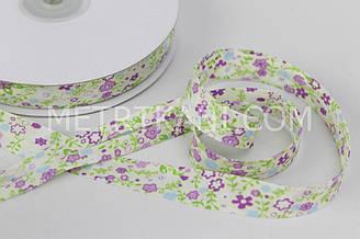 Хлопковая косая бейка с  фиолетовыми цветочками ,ширина 15 мм