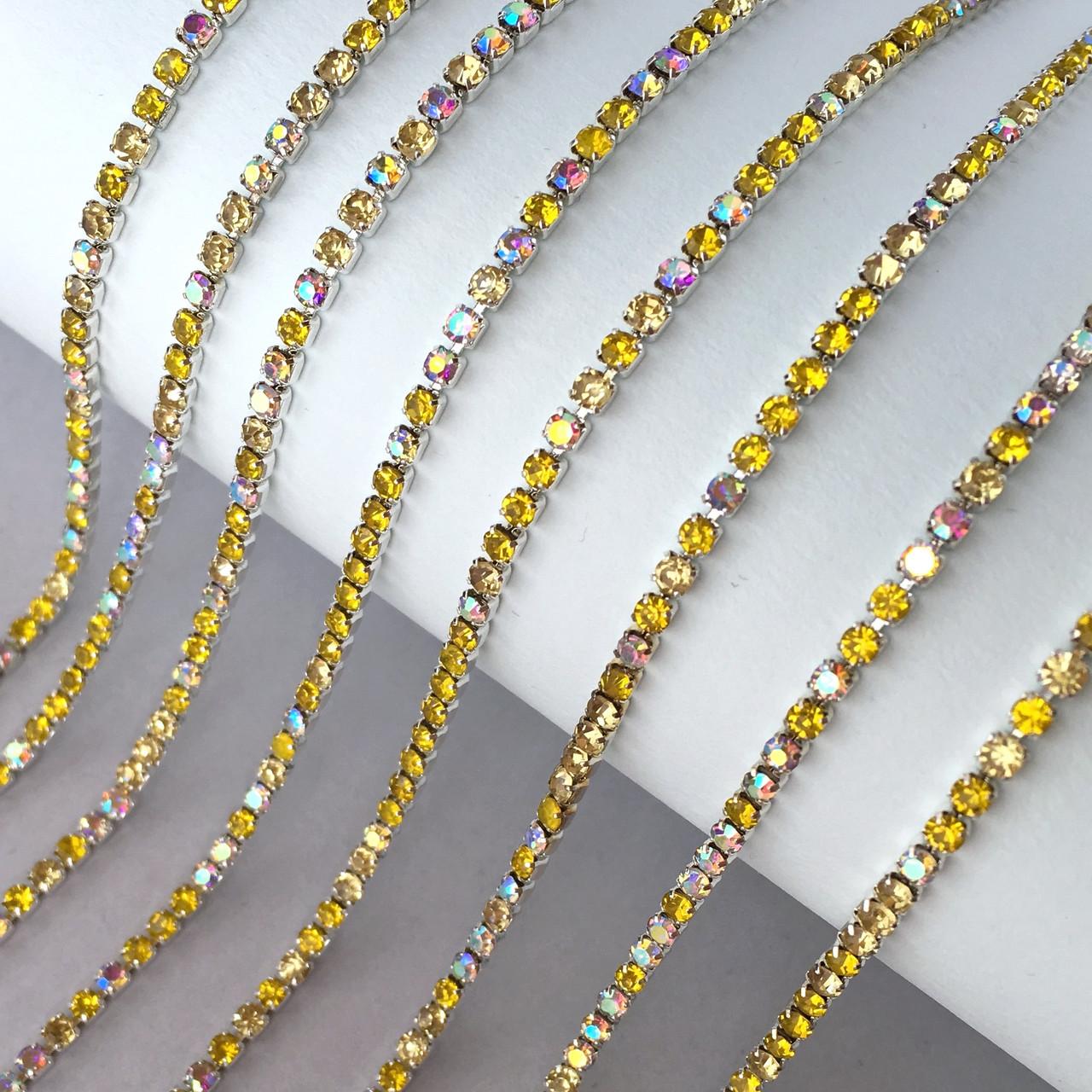 Стразовая цепь ss6 (2 мм). База: серебро. Цвет: Мультиколор - Желтый и прозрачный АВ