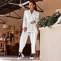 Женский классический костюм с широкими брюками белый