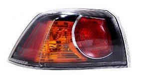 Левый задний фонарь Митсубиши Ланцер X, кузов седан, внешний, красно-черный, без платы / MITSUBISHI LANCER X (2008-)