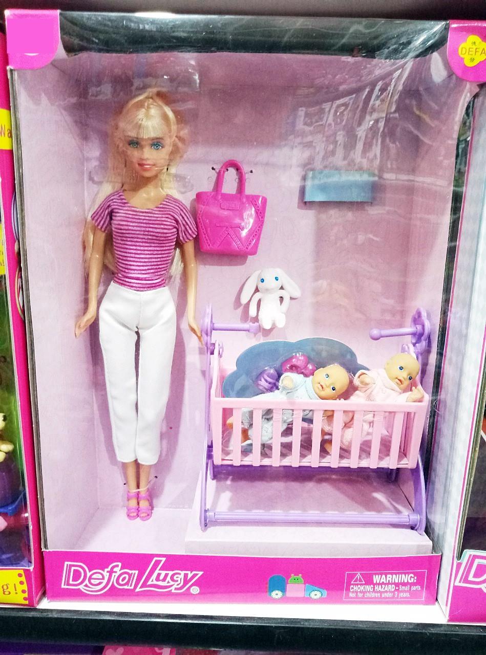 Кукла с пупсами в кроватке