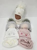 Детские утепленные вязаные шапки оптом со снудом, завязками и помпоном для девочек, р.46-48, Ambra (Польша)