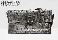 Женский клатч с черепом Alexander McQueen серебро