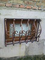 Кованые решетки на окна цокольного этажа