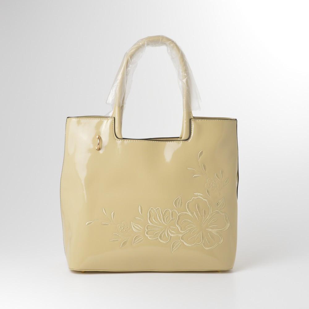 Женская сумка бежевая лакированая 13412