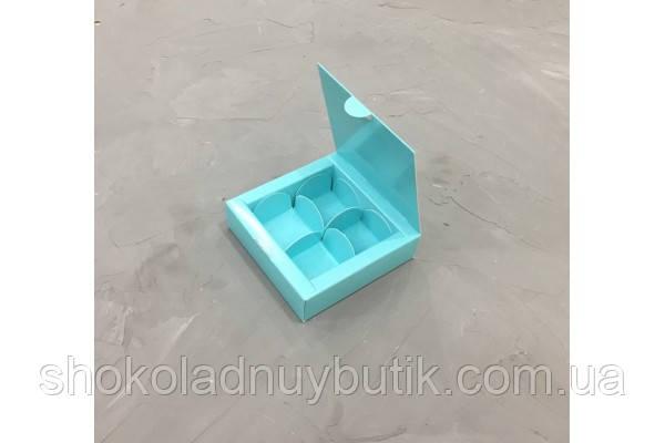 Коробка на 4 конфеты, бирюзового цвета.