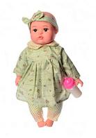 Пупс игрушечный в зеленой одежде с бутылочкой M 3887 UA LIMO TOY мягконабивной, музыкально-звуковой | куколка, фото 1