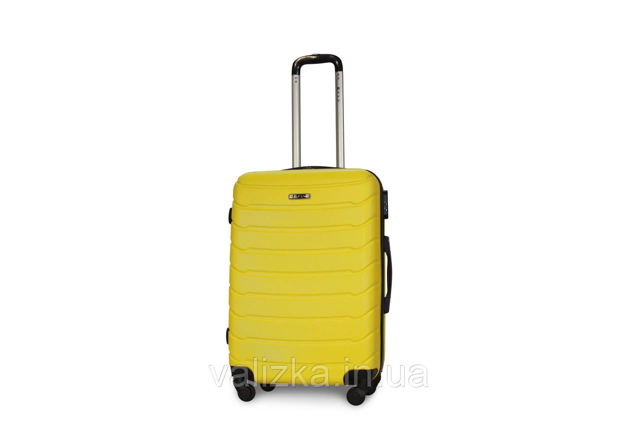 Чемодан пластиковый средний Fly на 4-х колесах желтый