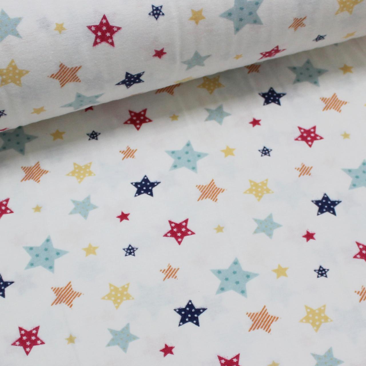 Фланелевая ткань (ТУРЦИЯ шир. 2,4) Звездопад красно-желто-голубой на белом