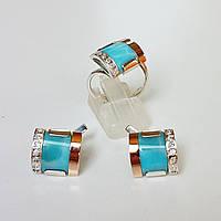 Серебряный комплект кольцо и серьги с золотыми вставками, ларимаром и фианитами