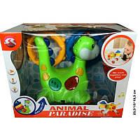 Муз. динозавр кольцеброс в коробке