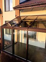 Для крыши использовали стеклопакеты с тонированным в массе стеклом Бронза и триплексом для безопасности.
