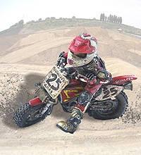 "Фигурка мотоциклиста ""Mud Warrior"" на кросовом мотоцикле красно-белого цвета из полистоуна"