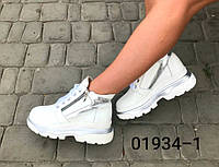 Женские кроссовки,сникерсы с натуральной кожи серебряного цвета. на шнурках.