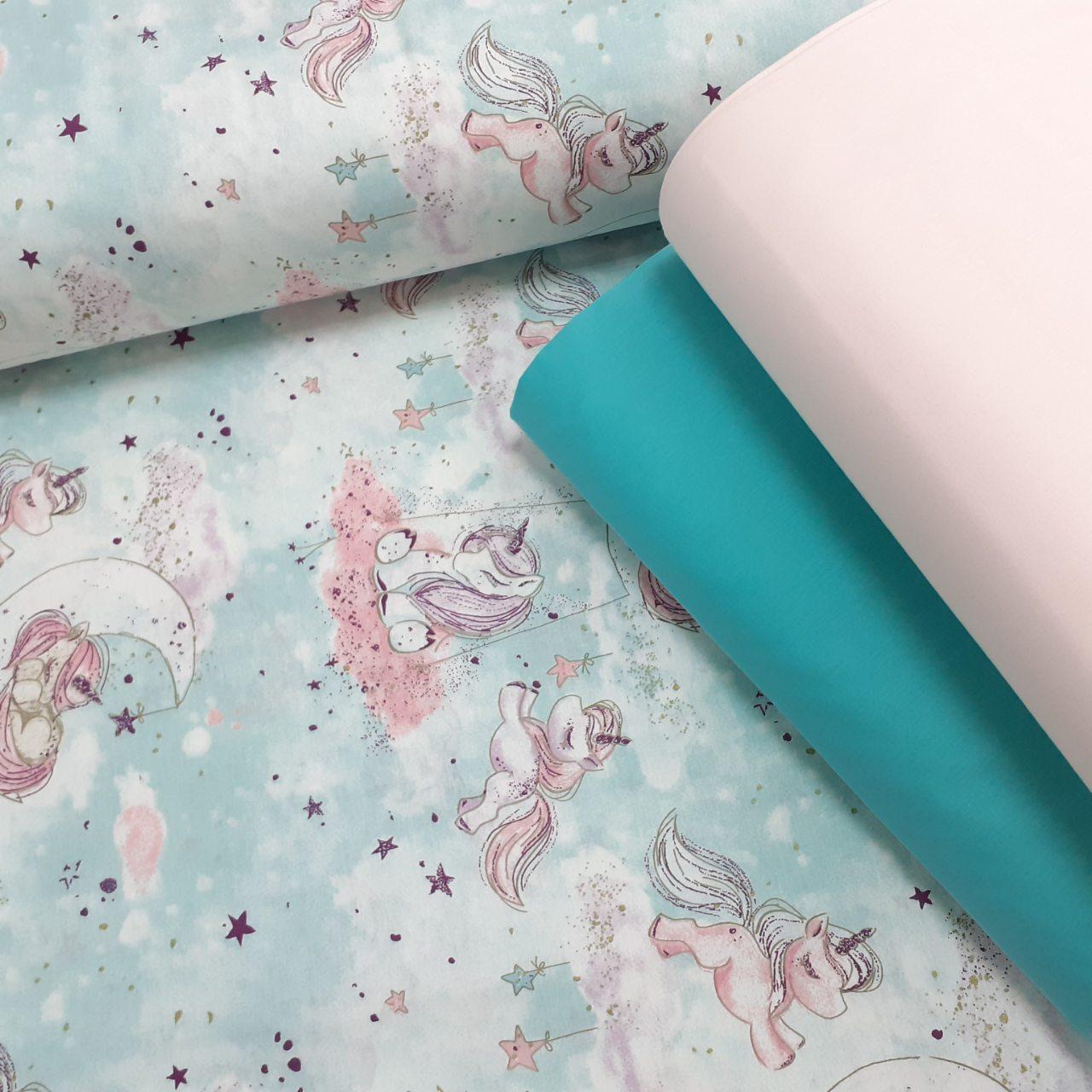 Хлопковая ткань (ТУРЦИЯ шир. 2,4 м) единороги с розовыми тучами на мятном (глиттер)