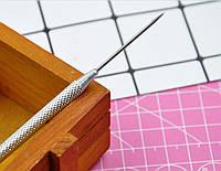Инструмент для работы с полимерной глиной.