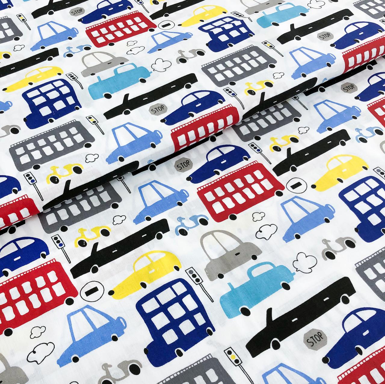 """Польская хлопковая ткань """"Машинки, автобусы, мопеды разноцветные красные, черные, голубые на белом"""""""
