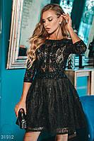 Короткое вечернее платье с расклешенной юбкой