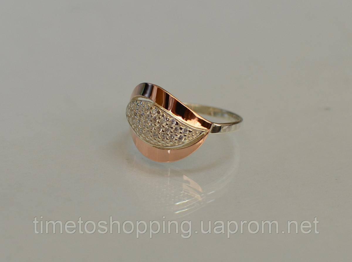 Серебряное кольцо с золотыми вставками и фианитами