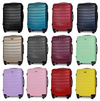 Средние пластиковые чемоданы Fly 1107