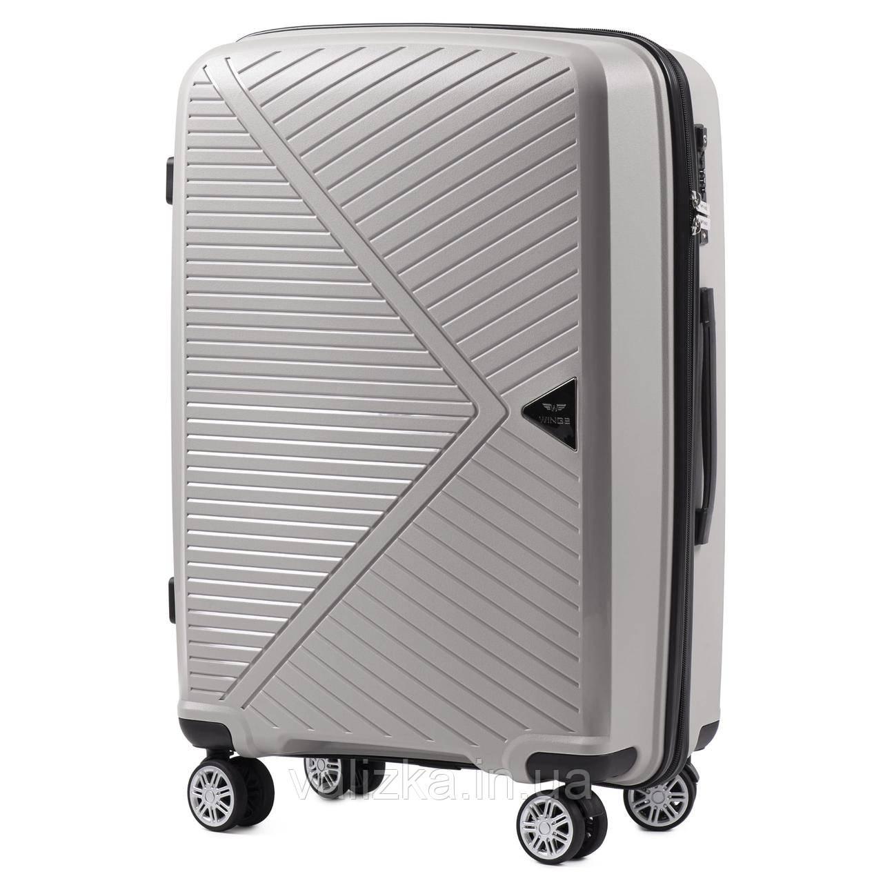 Средний чемодан из полипропилена премиум серии на 4-х двойных колесах с ТСА замком