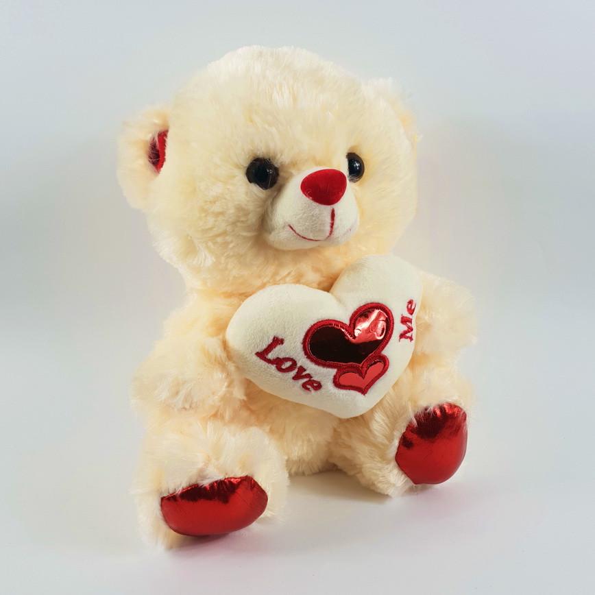 Мягкая игрушка медвежонок с сердцем love me музыкальная 22 см