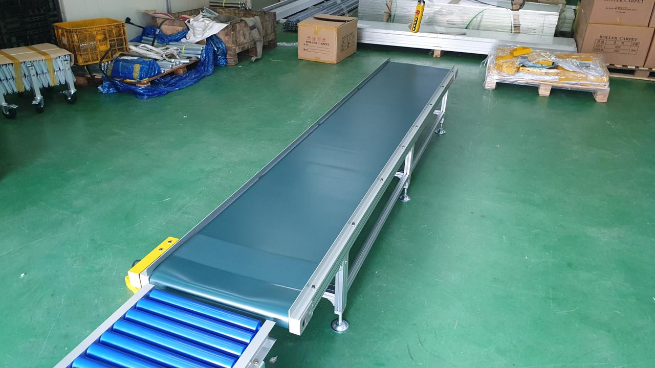 Конвейер ленточный для штучных грузов элеватор распатор с отсос